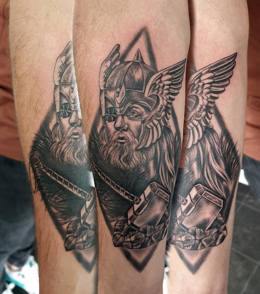 Odin viking god norse mythology thor hammer arm tattoo manchester