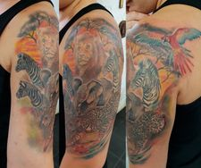 half sleeve wildlife african animals tattoo zebra jaguar parrot lion e