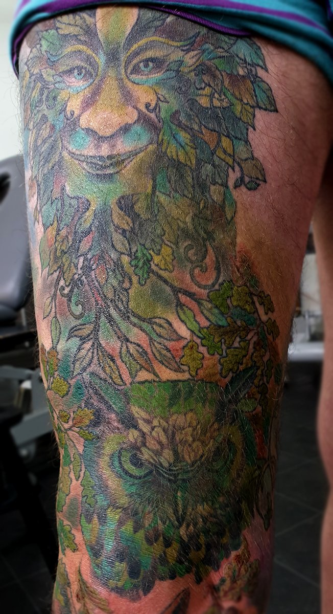leg sleeve tattoo green man nature