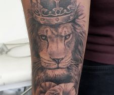 lion crown rose realism tattoo sleeve portrait manchester