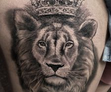 lion crown roses black grey leg tattoo manchester