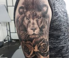 lion tattoo sleeve realism roses black grey manchester
