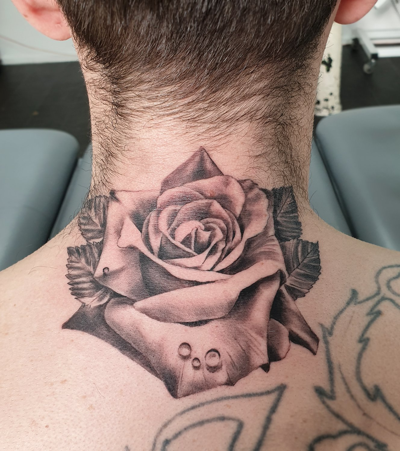 neck tattoo rose black grey manchester